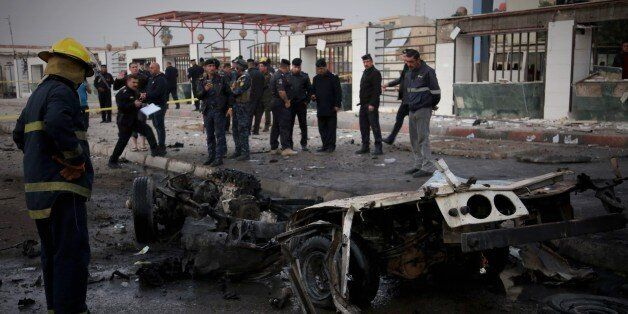 BAGHDAD, IRAQ - DECEMBER 31 : A wreckage of a car is seen after a car bomb attack at el-Cedide street...