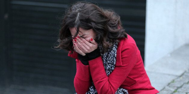 A former employee of the Reina nightclub reacts outside following an attack by a gunman in Istanbul,...