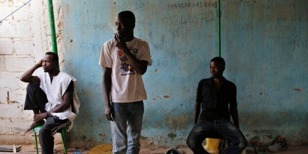 African migrants are seen at their temporary accommodation in Ghat, southwest Libya near the border with...