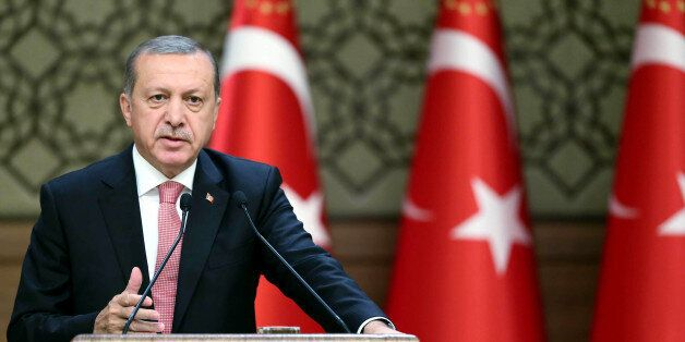 Turkish President Recep Tayyip Erdogan delivers a speech during an economic meeting with international...
