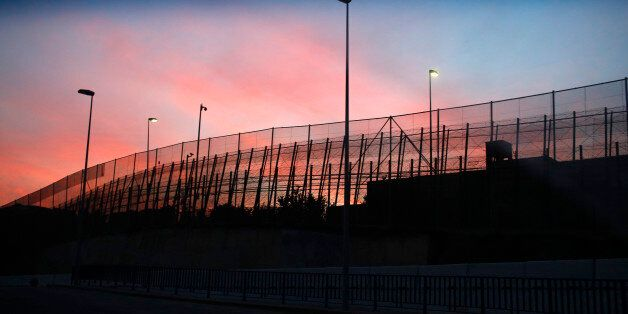 The border fence between Morocco and Spain's north African enclave Melilla is seen along a road, December...
