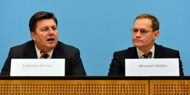 Berlin's mayor Michael Müller (R) and Interior Senator Andreas Geisel (L) give a press conference on...