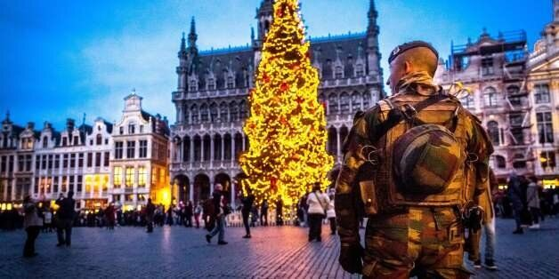 A serviceman patrols on the Grand-Place (Groote Markt) on the sidelines of the 'winter wonders' Christmas...