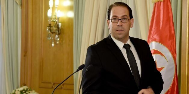 Tunisia's premier-designate Youssef Chahed speaks during a press conference to present his proposed new...