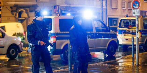 Policemen stand in front of a house in Dortmund, western Germany, on December 22, 2016.According to media...