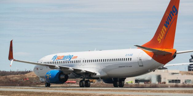 Goffs, Canada - May 3, 2015: A Sunwing Airlines flight taxis towards the gate at Halifax Stanfield International