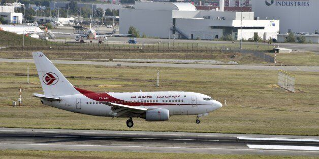 An Air Algerie aircraft lands at the Toulouse-Blagnac airport on September 29, 2014. AFP PHOTO / PASCAL...