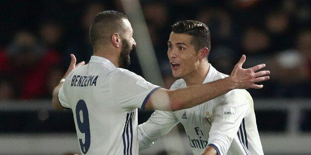 Real Madrid forward Cristiano Ronaldo (R) celebrates scoring during extra-time with teammate Karim Benzema...