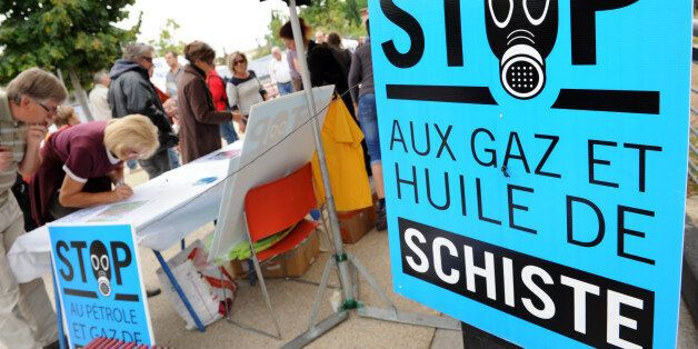 People sign a petition against the exploitation of shale gas and oil during a rally on September 22,...
