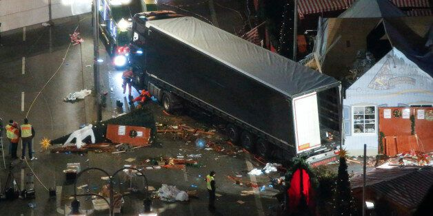 A used suit of a forensic investigator lies on a Christmas tree where a truck ploughed through a crowded...