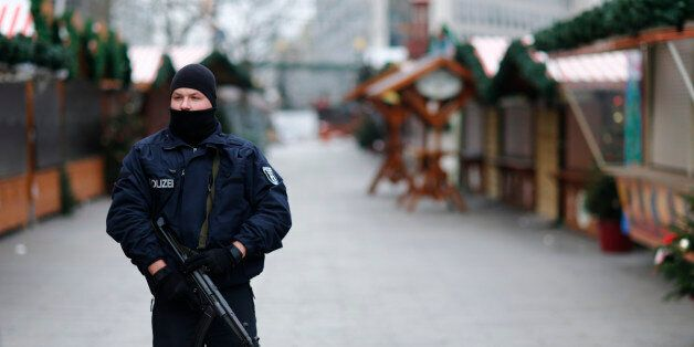 Police stands guard at the Kaiser-Wilhelm-Gedaechtniskirche Christmas market in Berlin, Germany, December...