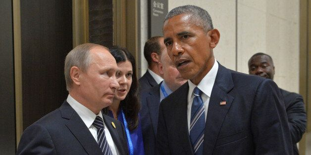 Russian President Vladimir Putin (L) meets with U.S. President Barack Obama on the sidelines of the G20...
