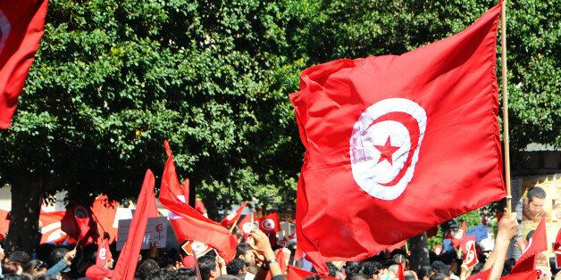 A crowd invades the streets during a demonstration to celebrate Tunisia's independence, Tuesday, March,...