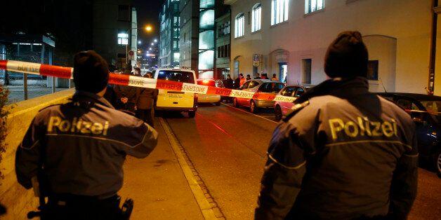 Police stand outside an Islamic center in central Zurich, Switzerland December 19, 2016. REUTERS/Arnd