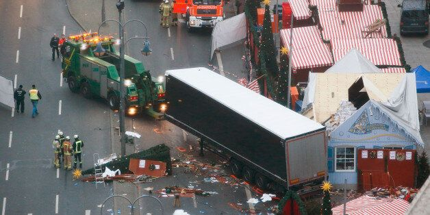 Rescue workers tow the truck which ploughed into a crowded Christmas market in the German capital last...