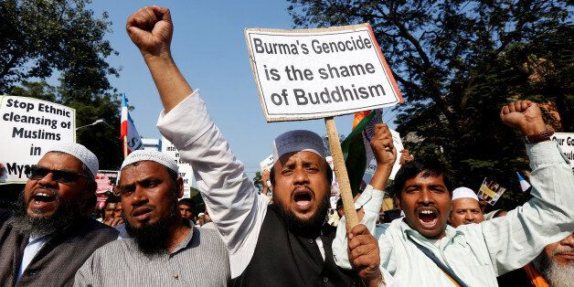 People shout slogans as they take part in a protest march against what they say are killings of Rohingya...