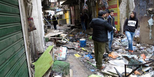 Iraqi security forces inspect the site of a bomb attack at a market in central Baghdad, Iraq December...
