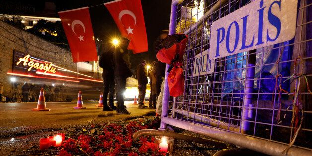 Flowers are placed in front of a police barrier near the entrance of Reina nightclub by the Bosphorus,...