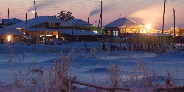 OMSK REGION, RUSSIA - DECEMBER 18, 2016: Snow covered residential houses in the village of Bolsherechye....