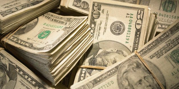 US Currency: Wads of US bills fastened with rubber bands,