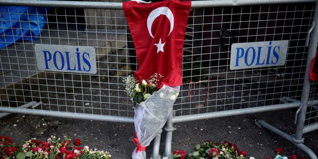 Flowers and a Turkish flag are placed near the entrance of Reina nightclub, which was attacked by a gunman,...