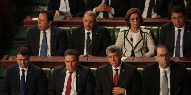 (Front row from L-R) Tunisia's Interior Minister Hedi Majdoud, Defence Minister Farhat Horchani, Justice...