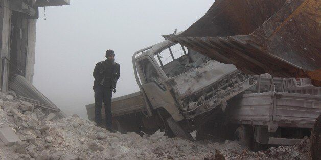ALEPPO, SYRIA - JANUARY 1: A man inspects the area after warcrafts belonging to Assad Regime forces attacked...