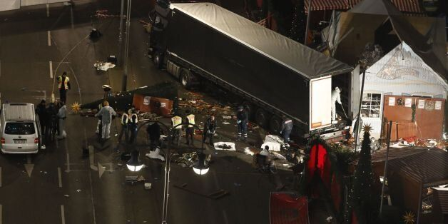 Authorites continue to remove bodies hours after a truck sped into a Christmas market in Berlin, on December...