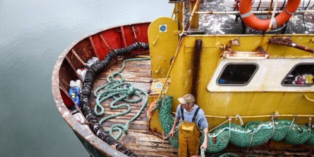 A fisherman prepares for the departure of the Trevessa IV fishing trawler vessel in Newlyn harbour in...