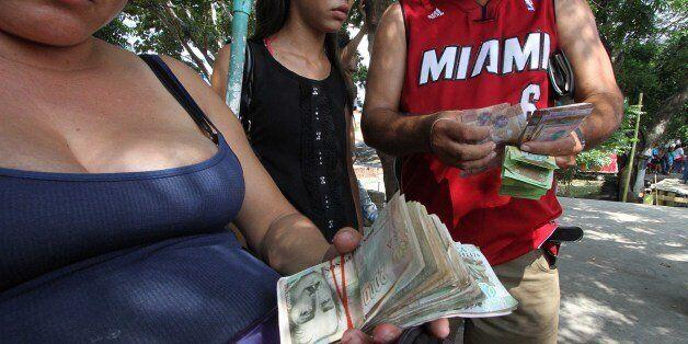 People exchange money to buy good in Cucuta, Colombia, before crossing the Francisco de Paula Santander...