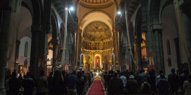 TUNIS, TUNISIA - DECEMBER 24: People attend a mass, led by Ilario Antoniazzi, Archbishop of Roman Catholic...