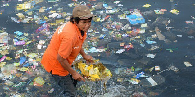 Plastic bags and other rubbish are collected from the waters of Manila Bay on July 3, 2014 during a campaign...