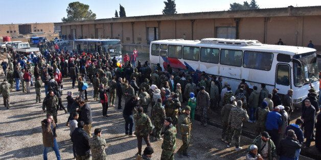 Syrians who were evacuated from Fuaa and Kafraya,two Shiite villages under rebel-siege on the northern...