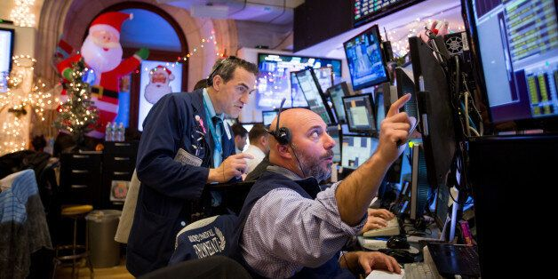 Traders work on the floor of the New York Stock Exchange (NYSE) in New York, U.S., on Monday, Dec. 12,...