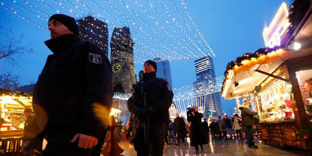 Police patrol at the re-opened Christmas market at Breitscheid square in Berlin, Germany, December 22,...