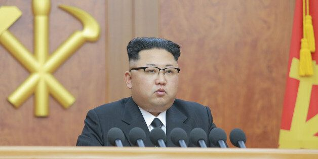 North Korean leader Kim Jong Un gives a New Year address for 2017 in this undated picture provided by...