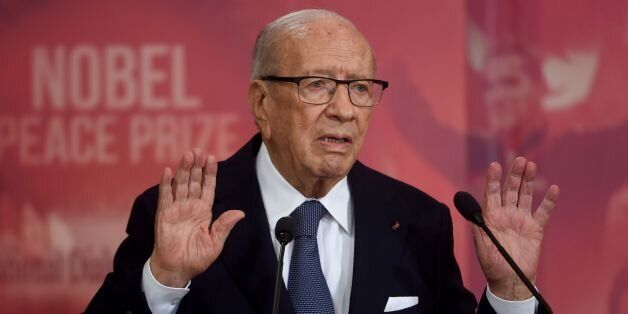 Tunisian President Beji Caid Essebsi gives a speech during a ceremony for the signing of documents outlining...