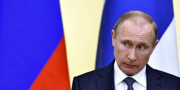 Russian President Vladimir Putin attends a joint news conference with his Finnish counterpart Sauli Niinisto...