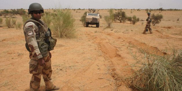 A French soldier stands next to an armored vehicle in Inat, Mali, May 27, 2016. REUTERS/Media