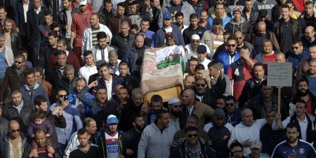 Relatives and friends carry the body of British-Algerian journalist Mohamed Tamalt as mourners walk towards...