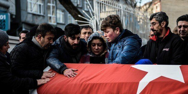 Relatives of Ayhan Arik, one of the victims of the Reina night club attack mourn during his funeral ceremony...