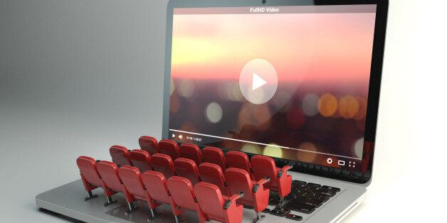 Video player app or home cinema concept. Laptop and rows of cinema seats, 3d