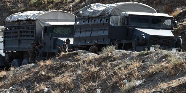 Algerian army troops carry out search operations in the mountainous eastern Tizi Ouzou region in a desperate...