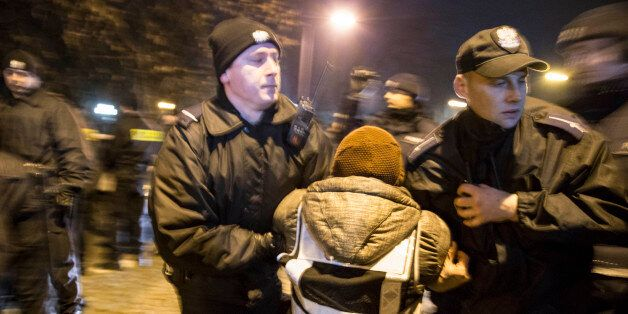 A police detain a woman during protest in Warsaw on December 17, 2016. Protest organized by KOD (Committee...