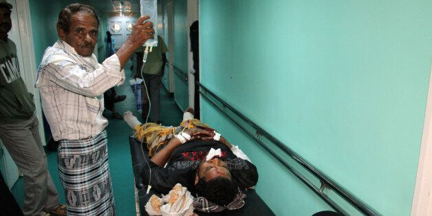 A wounded Yemeni receives treatment at a hospital in Aden on December 18, 2016, after a suicide bomber...