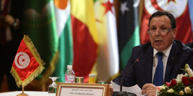 Tunisian Foreign Minister Khemaies Jhinaoui speaks during the 8th ministerial meeting of Libya's neighbouring...