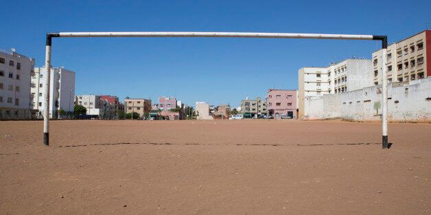 A soccer goalpost stands in a field in Rabat June 3, 2014. The 2014 Brazil World Cup opens on June 12...