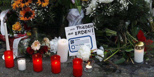 BERLIN, GERMANY - DECEMBER 20: A message reading freedom on Earth lays between flowers at the area after...