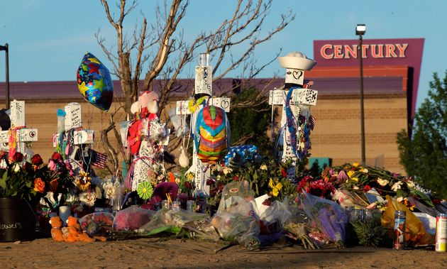 In this July 27, 2012, file photo, crosses honor of the victims of the Aurora, Colorado, movie theater...