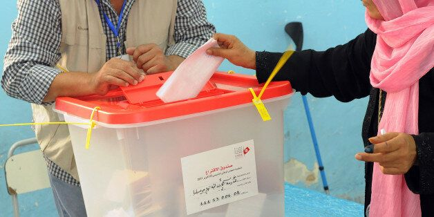 (GERMANY OUT) October 23, 2011- Tunis, Tunisia: A Tunisian woman is casting her vote for the 217-seat...